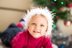 Baby near Christmas tree Stock Photo