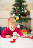 Baby near Christmas tree Stock Photos