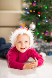 Baby near Christmas tree Stock Images