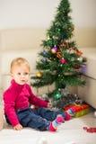 Baby near Christmas tree Royalty Free Stock Photo