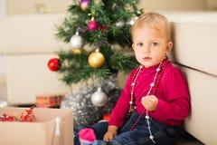 Baby near Christmas tree Royalty Free Stock Photos