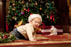 Baby near the Christmas tree. Little boy celebrati Stock Images