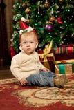 Baby near the Christmas tree. Little boy celebrati Royalty Free Stock Photography