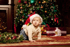 Baby near the Christmas tree. Little boy celebrati Royalty Free Stock Photos