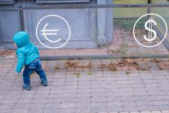Baby near the currency exchange office. Financial concept Royalty Free Stock Images