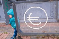 Baby near the currency exchange office. Financial concept Royalty Free Stock Photos