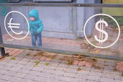 Baby near the currency exchange office. Financial concept Stock Photos