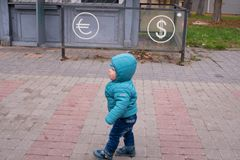Baby near the currency exchange office. Financial concept Royalty Free Stock Photography