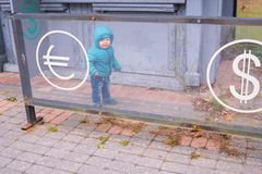 Baby near the currency exchange office. Financial concept Royalty Free Stock Image