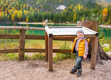 Baby near information board while on lake braies Royalty Free Stock Images