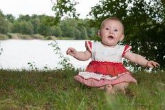 Baby near the lake royalty free stock photography
