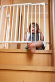 Baby near safety gate. Small baby approaching safety gate of  stairs Stock Photos
