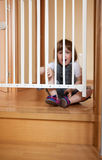 Baby near stair gate Royalty Free Stock Photography