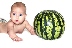 Baby near watermelon. Little baby with watermelon isolated on white Royalty Free Stock Image