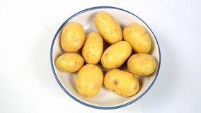 Baby New Potatoes. Close view of Raw Baby new potatoes stock video footage