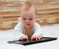 Baby with new tablet PC Stock Image
