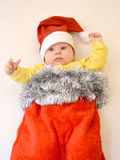 The baby in a New Year's suit of Santa Claus on a light backgroun Stock Images
