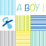 Baby newborn birth announcement card boy with a dummy on a strip. Baby birth announcement card with the text A Boy on a striped pattern of blue, green, yellow stock illustration