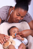 Baby newborn with mother Stock Image