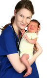 Baby Newborn and Nurse. Beautiful young nurse holding a newborn baby over white background Royalty Free Stock Photos