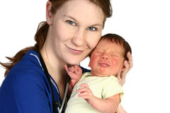 Baby Newborn and Nurse. Beautiful young nurse holding a newborn baby over white background Royalty Free Stock Image