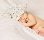 Baby newborn portrait, kid sleeping in hat Stock Image