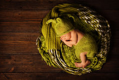 Baby newborn portrait, kid sleeping in woolen hat Royalty Free Stock Images