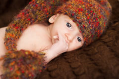 Baby Newborn Portrait in woolen hat, New Born Kid Stock Photo