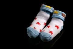 Baby newborn Shock at black Stock Photo
