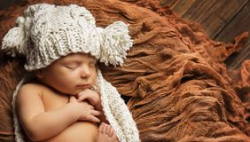 Baby Newborn Sleep in Knitted Hat, Sleeping New Born Child. Baby Newborn Sleep in Knitted Hat, New Born Child Sleeping on Brown Blanket, Asleep Infant Kid royalty free stock photo