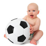 Baby next to soccer ball Stock Photos