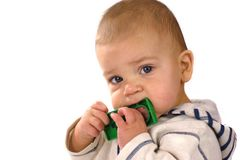 Baby nibbling toy Royalty Free Stock Photos