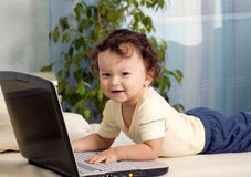 Baby with notebook. Royalty Free Stock Image