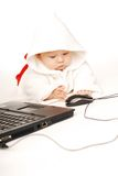 Baby and notebook Royalty Free Stock Photos