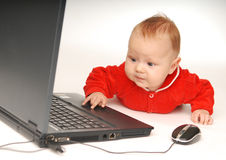 Baby and notebook Stock Photo