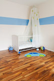 Baby nursery with bed Royalty Free Stock Image
