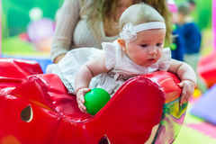 Baby in nursery. One of the babies playing in the nursery Royalty Free Stock Photo