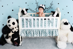 Baby nursery room. Baby sitting in his cradle in his nursery room