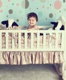 Baby nursery room. Baby sitting in his cradle in his nursery room Royalty Free Stock Images