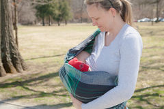Baby Nursing in Sling Royalty Free Stock Image