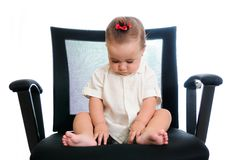 Baby in office armchair Royalty Free Stock Image