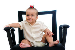 Baby in office armchair. A smiling baby girl sitting in an office chair, wearing a white shirt. isolated in white Stock Photography