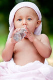 Baby and an oil bottle Stock Image