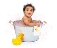 Baby in an Old Tub With Rubber Duckie Stock Photo
