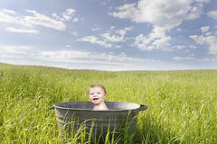 Baby in an old vintage bathrub, outdoors Royalty Free Stock Photos