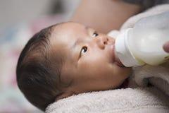 Free Baby On Bottle Feeding Stock Images - 108994014