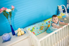 Baby On Crib At Home Stock Photo