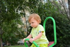 Baby one year old walks with pacifier stock image