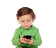 Baby with one years old playing with a mobile Stock Photography