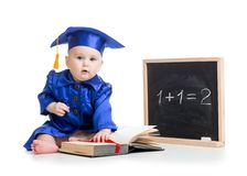 Baby with open book in academician clothes at Royalty Free Stock Photo